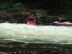 kayakers-in-rapids